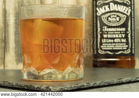 Warsaw, Poland - May 22, 2021: Glass Of Jack Daniels Whiskey With Ice. Whiskey On Ice In A Glass And