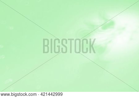 Blur, Noise, Defocus. Abstract Soft White-green Background With The Shadow Of An Angel. Blurred Vibr