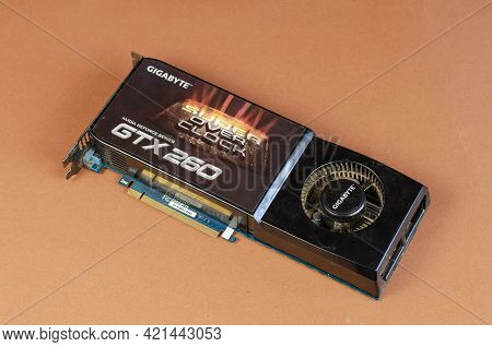 Graphics Card Brand Gigabyte Nvidia Geforce On A Brown Background. Dusty Computer Components. Repair