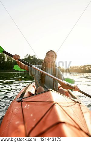 Active Young Woman Paddling Kayak On A Lake Together With Her Boyfriend On A Summer Afternoon. Kayak