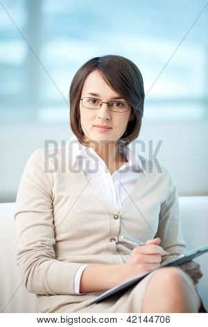 Portrait of pretty counselor being ready to take notes