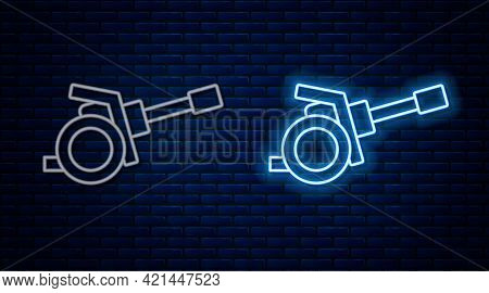 Glowing Neon Line Howitzer Icon Isolated On Brick Wall Background. Shooting From A Gun. Artillery. V