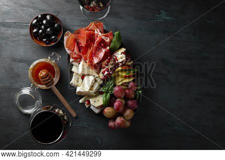 A Set Of Appetizers For Wine, Jamon, Pepperoni, Cheese, Grapes, Peach And Olives On A Plate Top View
