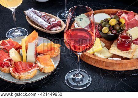 Rose Wine And Italian Antipasti Or Spanish Tapas In A Bar. Blue Cheese, Prosciutto Di Parma Ham, Jam