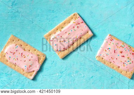 Pink Pop Tarts On A Blue Background, Top Shot Of Toaster Pastry