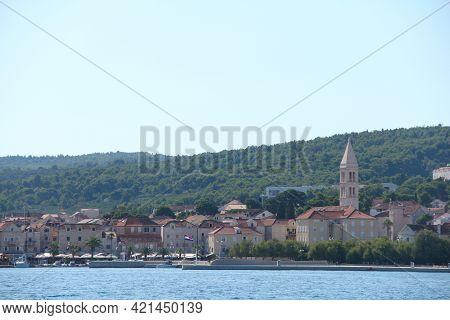Supetar City In Brac Island, Croatia, View From The Sea