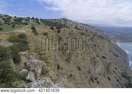 A Steep Cliff At A Small Plateau At The Top Of Cape Alchak. Sudak, Crimea. Cloudy Day At The End Of
