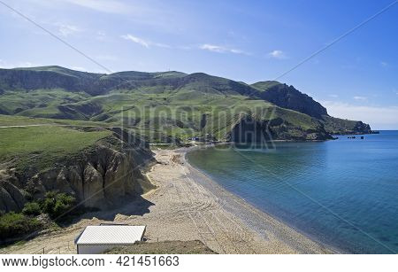 Calm Sea And Empty Sandy Beach In Kapsel Bay At The Foot Of Cape Meganom. Off-season. Crimea, End Of