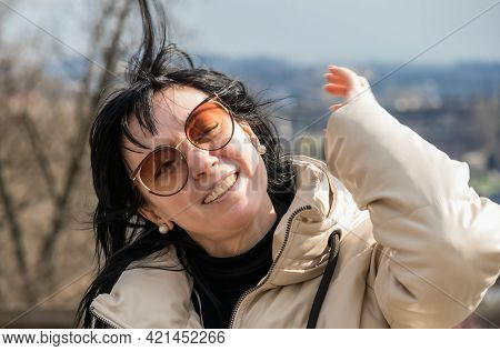 Portrait, 40 Year Old Woman European Beautiful Cheerful Perky Laughing With Dark Hair