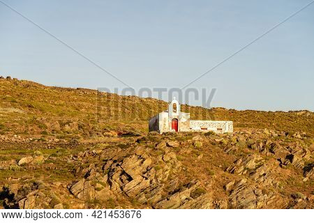 Old Whitewashed Abandoned Church Agios Ioannis On Dramatic Cliff On Kithnos Island, Greece, Seen Fro