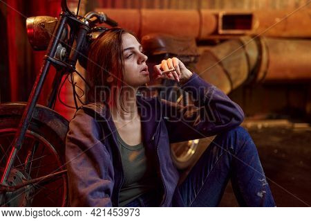 Drug addict woman smokes cigarette while she high