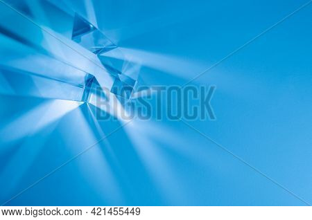 Glass prisms and cubes with color spectrum rays. Abstract background with reflection and refraction of light. Shadow and rays of natural light effects.