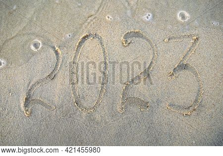 New Year, Number 2023 On Beach Sand. Holiday Concept.