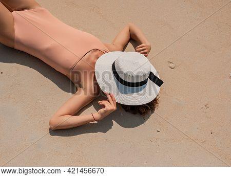 Young Beautiful Girl In Nude Luxury Bikini Posing On The White Sand Seashore. Blue Ocean Background.