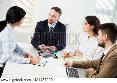 Businessman explains to colleague a new project in the modern office