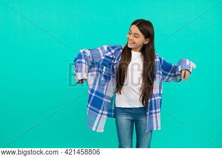 Happy Tween Girl Try On Stylish Plaid Shirt Blue Background, Oversize