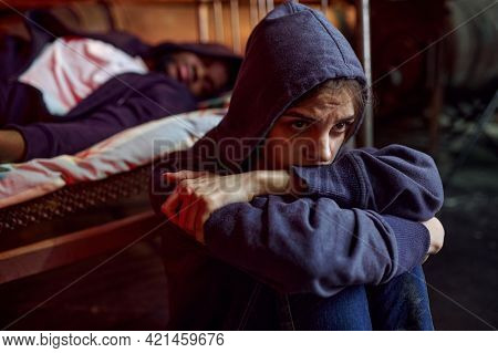 Drug addict man and woman took a dose in den