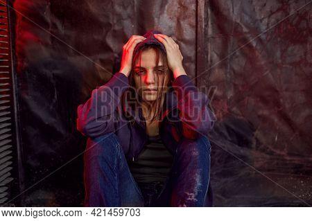 Drug addict female person in high, den
