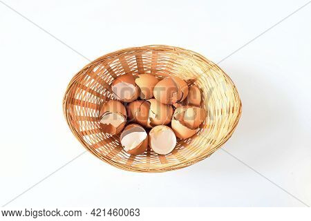 Cracking Open Egg Shelles In Bamboo Basket On White Background. Top Calciem Nutrition Wast Natural I