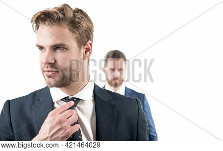 Young Man Businessman With Serious Face Fix Necktie In Formalwear Isolated On White, Portrait