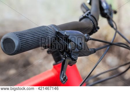 Handlebar With Rubber Handles, Brake Levers And Shifting Mechanism Of Gear Change Of Modern Bicycle,