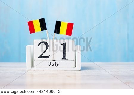 Wooden Calendar Of July 21th With Miniature Belgium Flags. Belgian National Day And Happy Celebratio
