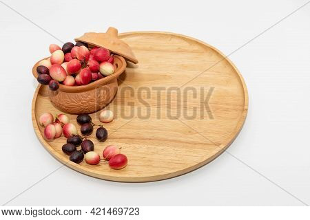 The Mango Yawn With Lemon Yawn In A Cup That Is Placed On A Wooden Tray