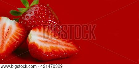 Fruit Background. Strawberries On A Red Background.strawberries Close-up. Side View, Close-up, Horiz