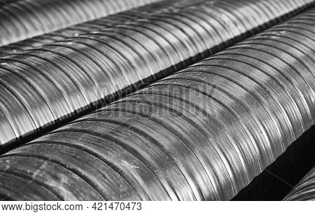 Anti-corrosion Tape Coating On New Steel Pipes. There Are Several Pipes In The Frame