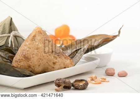 Zongzi. Rice Dumpling For Dragon Boat Festival On Bright Wooden Table Background With Ingredient.