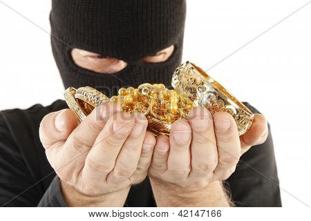 Masked man is holding stolen gold