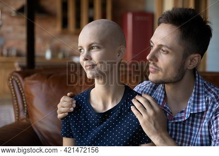 Thoughtful Husband Giving Support And Empathy To Hairless Wife