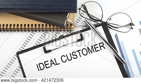 Text Ideal Customer On Office Desk Table With Notebooks, Supplies,analysis Chart, On White Backgroun