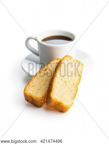 Sliced sponge dessert. Sweet sponge cake and coffee cup isolated on white background.