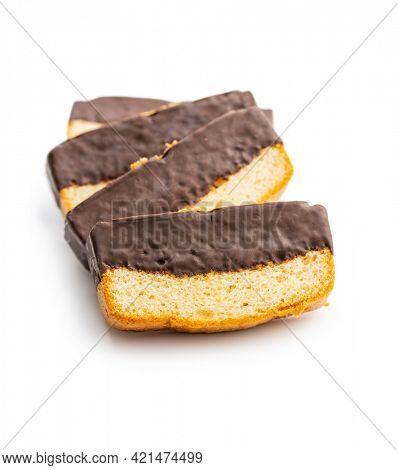 Sliced sponge dessert. Sweet sponge cake with chocolate isolated on white background.