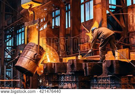 Liquid Iron Molten Metal Pouring From Ladle Container Into Mold, Industrial Metallurgical Factory, F