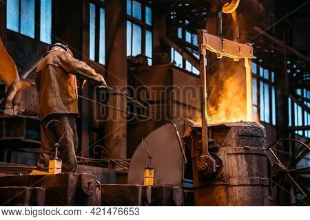 Iron Cast Process, Ladle With Liquid Molten Metal And Worker, Metallurgical Factory, Foundry Cast, H
