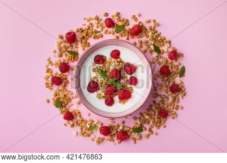 Bowl With Greek Yogurt, Raspberries And Granola. Top View Flat Lay. Healthy Snack And Nutrition Brea