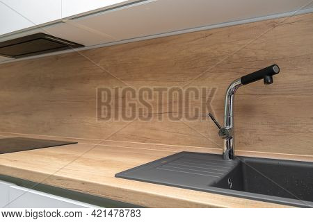 Interior Of A Modern Kitchen With A Faucet And Sink, Minimalism