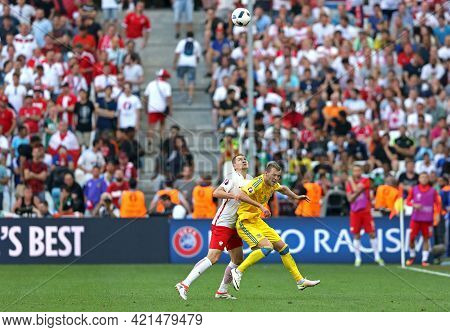 Marseille, France - June 21, 2016: Andriy Yarmolenko Of Ukraine (in Yellow) Fights For A Ball With A