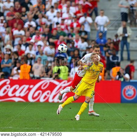 Marseille, France - June 21, 2016: Olexandr Zinchenko Of Ukraine (in Yellow) Fights For A Ball With