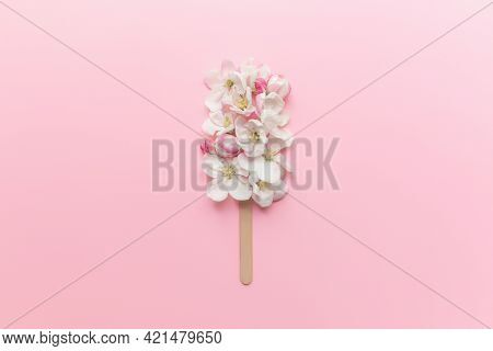 Greeting Card Concept Flat Lay On Pink Background With Apple Blossom Ice Cream Lolly On A Stick. Hig
