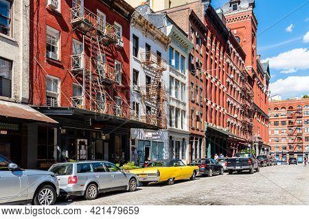 New York City, Usa - June 25, 2018: Street Scene With Classic Yellow Cadillac Eldorado Convertible C