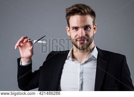 Fashion Is His Life. Mens Hair Styling And Grooming. Young Handsome Guy In Suit Hold Scissors. Male