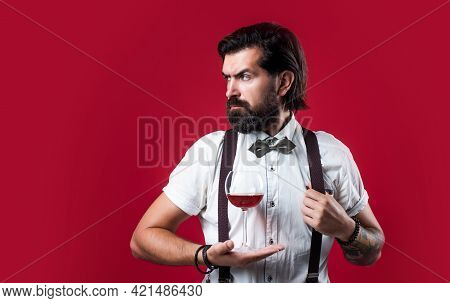 Be The Best. Stylish Sommelier Tasting Beverage. Old Fashioned Bearded Winemaker. Trendy Man In Susp