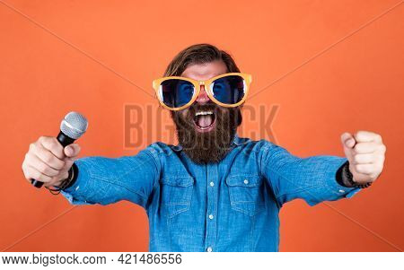 Good Day. Male Sing Music In Microphone. Funny Bearded Man With Mic. Brutal Caucasian Hipster In Par