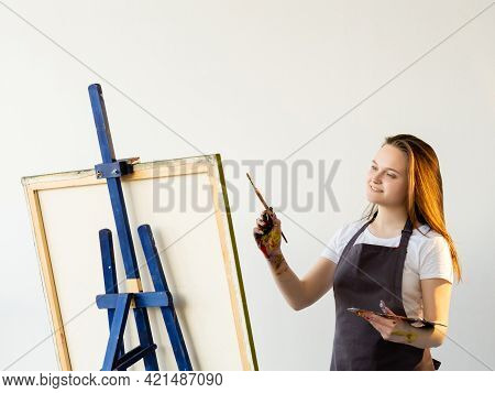 Female Artist. Creative Process. Enjoying Moment. Inspiration Muse. Smiling Woman In Apron Painting