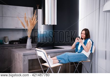 Shopping Or Ordering Delivery Online With Mobile Smart Phone. Happy Young Woman Using Cellphone At H