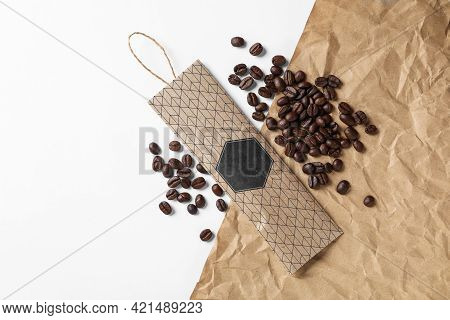 Scented Sachet And Coffee Beans On White Background, Flat Lay