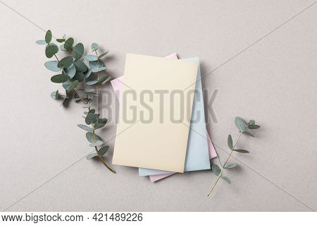 Scented Sachets And Eucalyptus Branches On Grey Table, Flat Lay